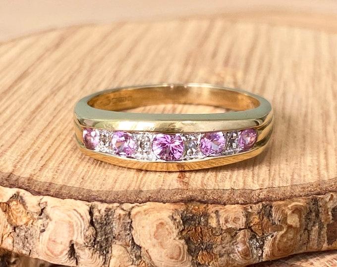 Gold tourmaline ring. A 9k yellow gold pink tourmaline and diamond ring