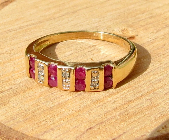 9K yellow gold ring, with round cut rubies and diamond accents