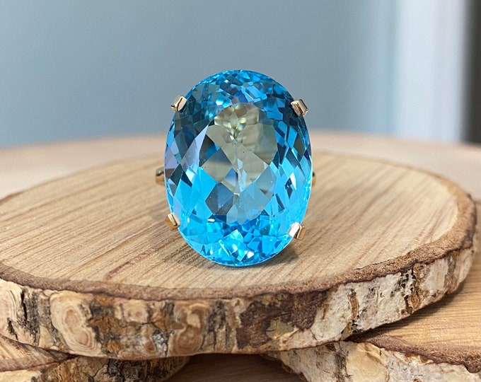 Gold Topaz ring. A big 32.5 carat natural Swiss blue topaz, claw set as a solitaire 9K yellow gold ring.