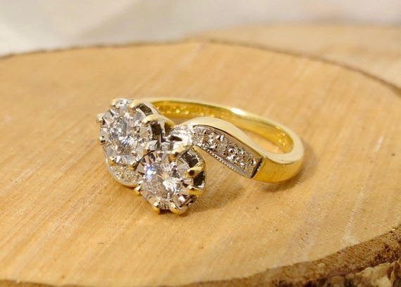 Small sized 18k yellow gold twin 1/4 carat diamond crossover ring. Free Resizing