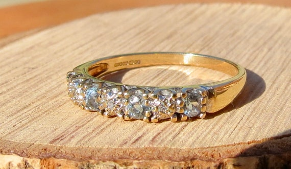 A vintage 9k yellow gold aquamarine and diamond ring