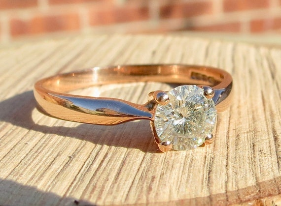 A 9K rose gold, 1 carat solitaire diamond ring.