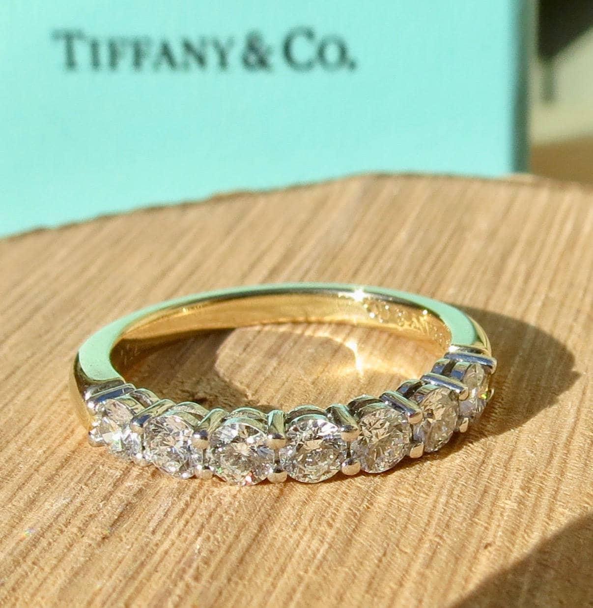 1ebee7835 Tiffany & Co 18k and Platinum 7 stone 3/4 carat diamond ring. Free ...