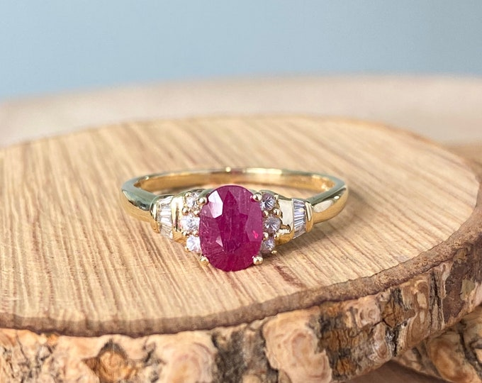 Gold ruby ring. A 9K yellow gold 1 carat diamond and white topaz ring.