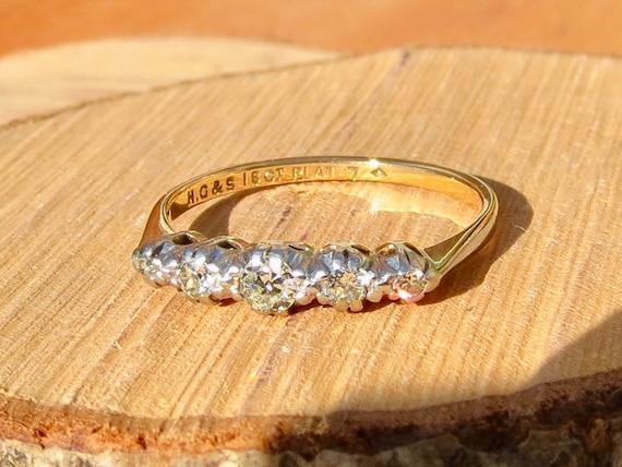Antique 18k yellow gold and platinum, 'Swiss cut' graduated diamond ring.