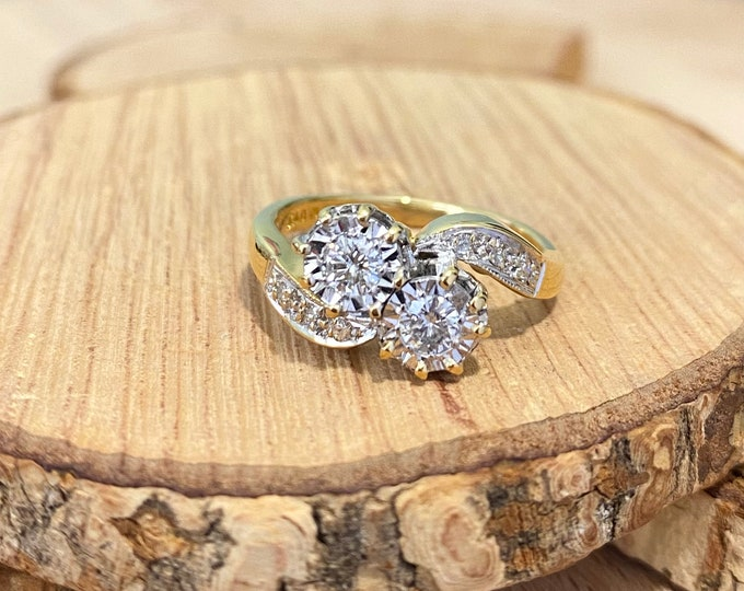 Gold diamond ring. Small sized 18k yellow gold twin 1/4 carat diamond crossover ring. Free Resizing