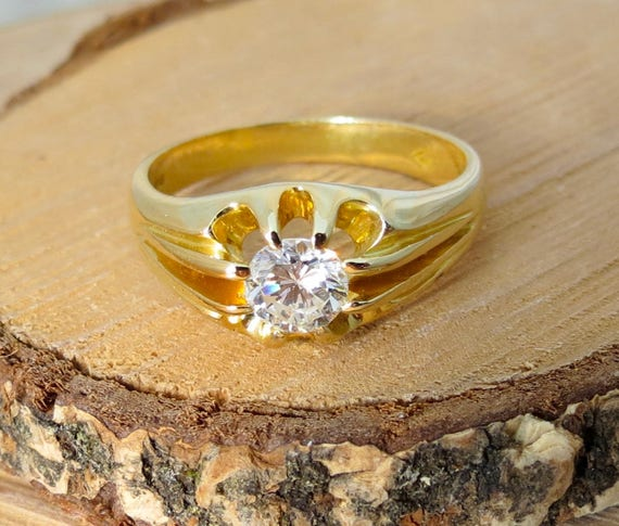 An 18K yellow gold 2/3 carat diamond solitaire ring