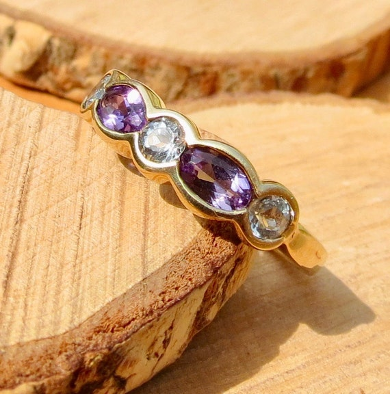 A vintage 9K yellow gold amethyst and topaz ring