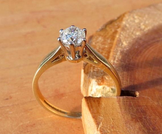 1/2 Carat diamond solitaire 18k yellow gold ring.