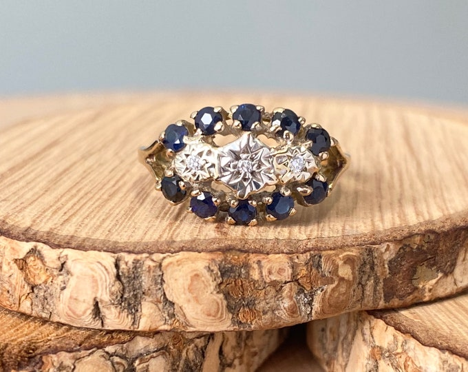 Gold sapphire ring. A vintage 18k yellow gold diamond and sapphire ring