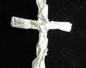 Fused silver cross.