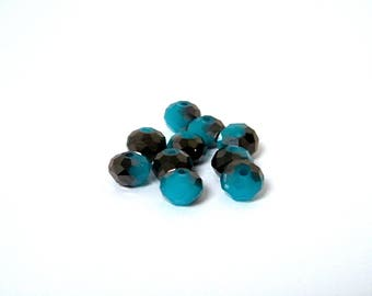 Glass beads, faceted, blue color with black coating, 8 x 6 mm by 10