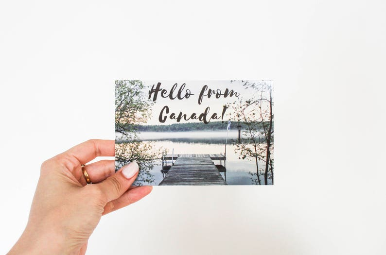 Canada postcard cottage mist dock lake hello from canada image 0