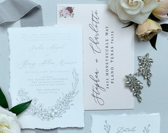 Metallic Silver & Pale Pink on White Linen with Deckled Torn Edges Calligraphy and Delicate Hand Drawn Floral Flowers Wedding Invitation