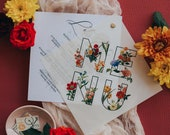 Vellum Overlay Menu Bound with Eyelet Featuring Bright Summer Florals in Red, Blue, Orange & Yellow