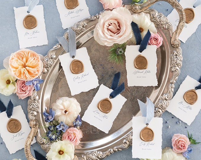 White and Navy Blue Wedding Escort Cards Cards with Torn Edges, Delicate Calligraphy Script and Wax Seal with Guest Names and Ribbon