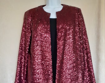 Short jacket straight edge-to-edge in crushed raspberry sequin fabric