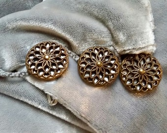 3 old metal buttons with a rosette pattern on a metal tailed background