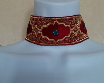 Neck or Choker on red and gold ribbon with turquoise rhinestones to tie