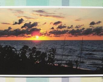 Setting sun dipping below clouds - 8x14 inch print