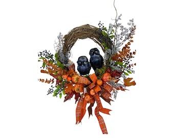 Fall wreath with Halloween black owls , orange pumpkins on grapevine.