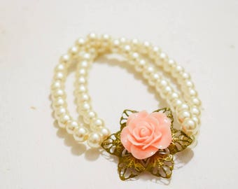 cream pearl stretchy bracelet with gorgeous acrylic floral accent
