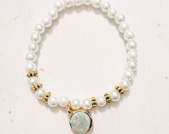 pearl stretchy bracelet with gold accents and mint green sparkly stone bead