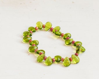 "Holly Inspired Stretchy Bracelet - Green Glass Leaves with Red ""Berry"" Beads"