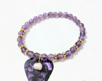 Purple homemade marble glass and pearl guitar pick stretch bracelet