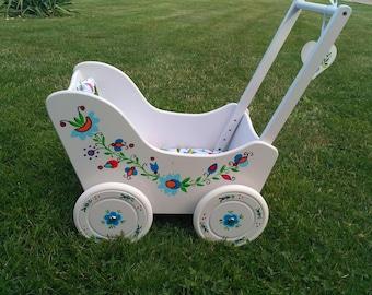 Doll stroller, painted in folk patterns