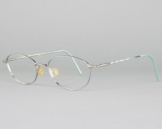 1990s Vintage Eyeglasses | 90s Glasses | Oval Glasses Frames | Silver Eyeglass Frame with Baby Blue Accent | Vintage Deadstock - Angelica