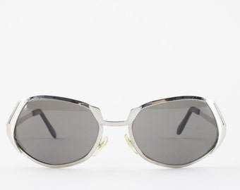 60s Vintage Sunglasses   Unique Oval Sunglasses with Silver Cutout   1960s Sunglasses   Grey Glass Lenses   NOS Vintage Deadstock - Bowie XX