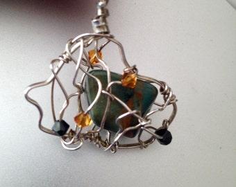 wire wrapped stone with Swarovski crystals