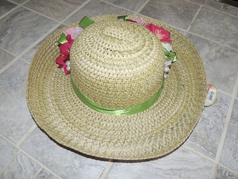 Beautiful Bamboo hat with hot pink and cream colored flowers Super cute to wear and hang on the wall when done.