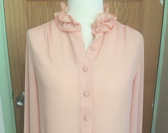 Peach 1970s vintage blouse with ruffle collar and cuffs size 14