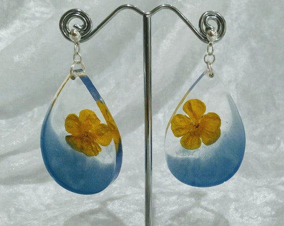 Dangle drop earrings made with real buttercups and clear and blue resin detail