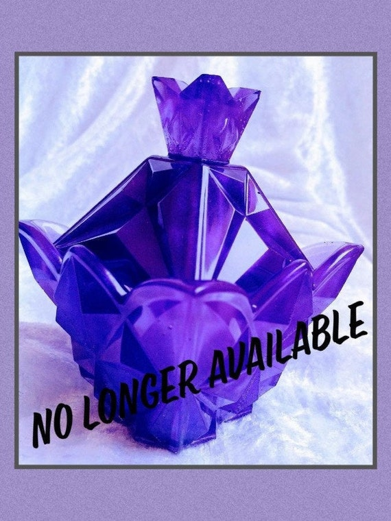 Beautiful crystal look perfume bottle shaped trinket box in a stunning purple colour.