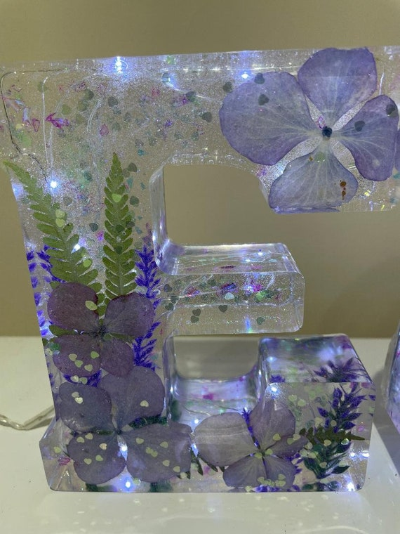 Huge 6 inch tall letter with various flowers etc and lights.
