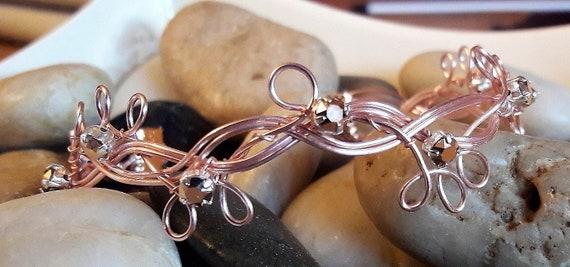 Beautiful rose gold bangle with rose gold chantun crystals