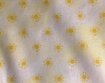One Half Yard of Fabric Material - Sun Images on Yellow/White