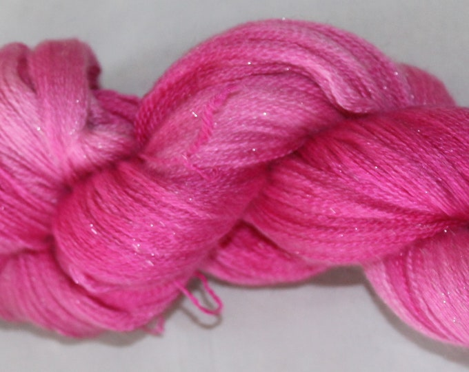 Hand painted extra fine merino, silk and silver sparkle yarn in hot pink geranium colours.