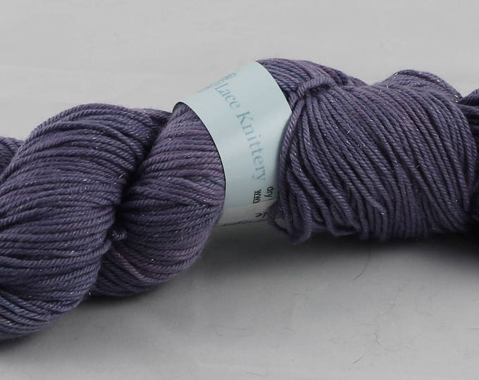 Space dyed yarn, double knit extra fine merino and silk with silver stellina sparkle in purple colours