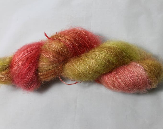 Hand painted, lace weight kid mohair and silk yarn in soft pinks, greens and oranges.