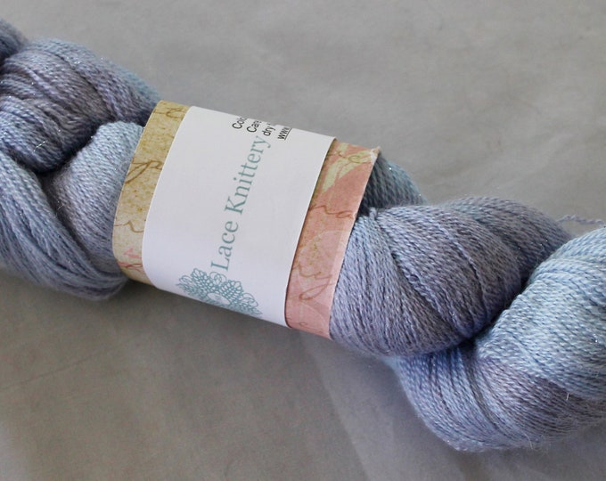 Hand painted extra fine merino, silk and silver sparkle in the colours of a wisteria flower