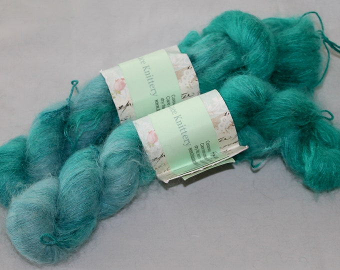 Hand painted kid mohair and silk lace weight yarn in halcyon colour  way