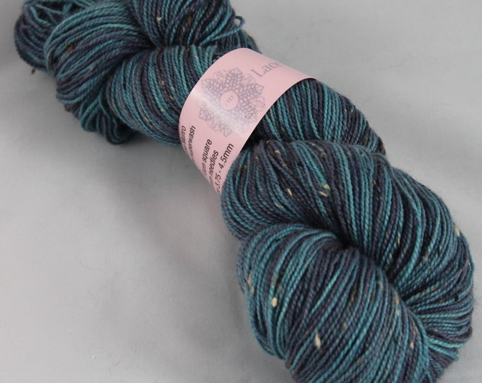 Hand painted double knitting yarn in super wash merino and donegal nep in navy and blues