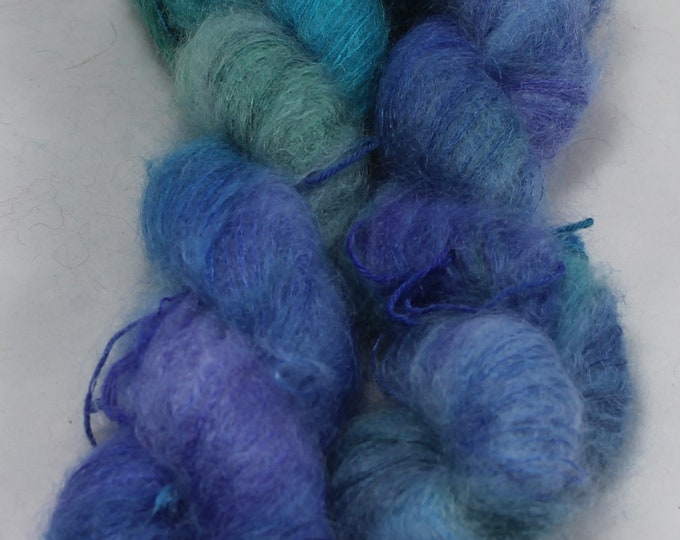 Hand painted kid mohair and silk yarn in the colours of a peacock feather