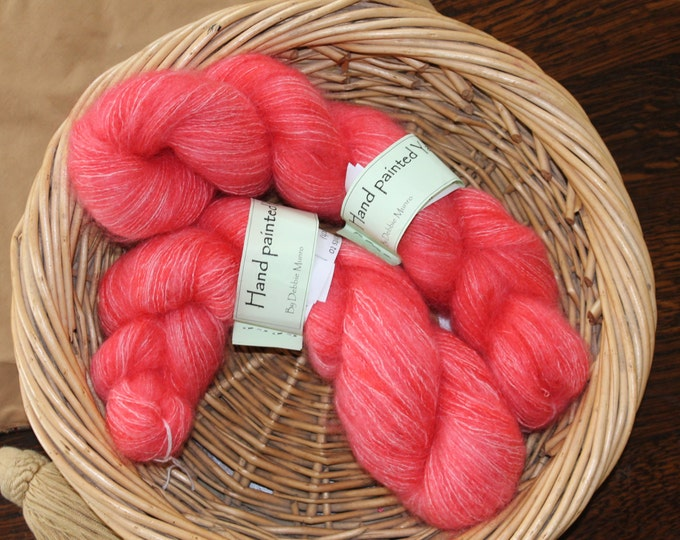 hand painted kid mohair and silk yarn in the colours of candy floss and seaside rock
