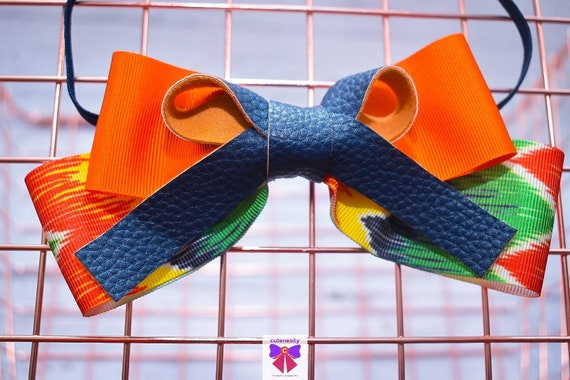 Tribal print orange and navy grosgrain and leather Bow- Baby / Toddler / Girls / Kids Headband / Hairband / Hair bow / Barette / Hairclip