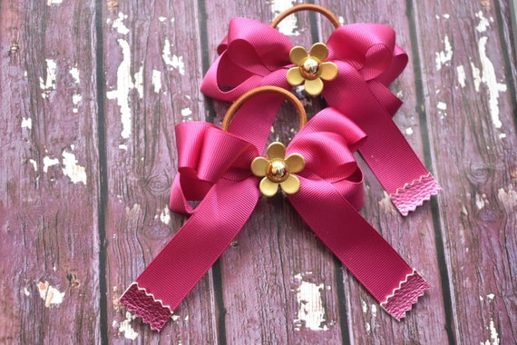 Pair of fuchsia pink and gold daisy bows / hair ties / pigtail bows / pony tail ties / flowergirl bow / birthday bows / leather bow